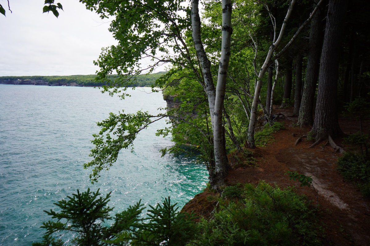 trail along lake superior at pictured rocks, between chapel beach and grand portal point
