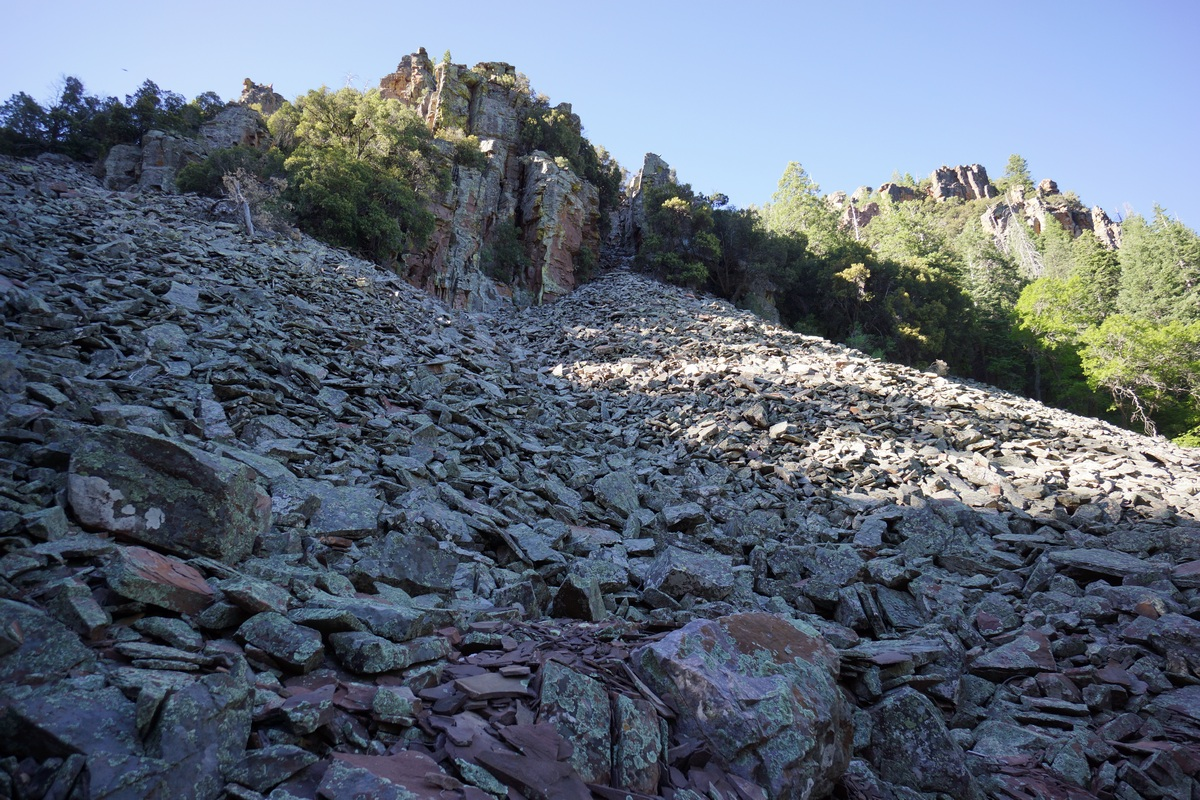 hiking across a scree slope in the sierra ancha wilderness along trail 160, parker creek