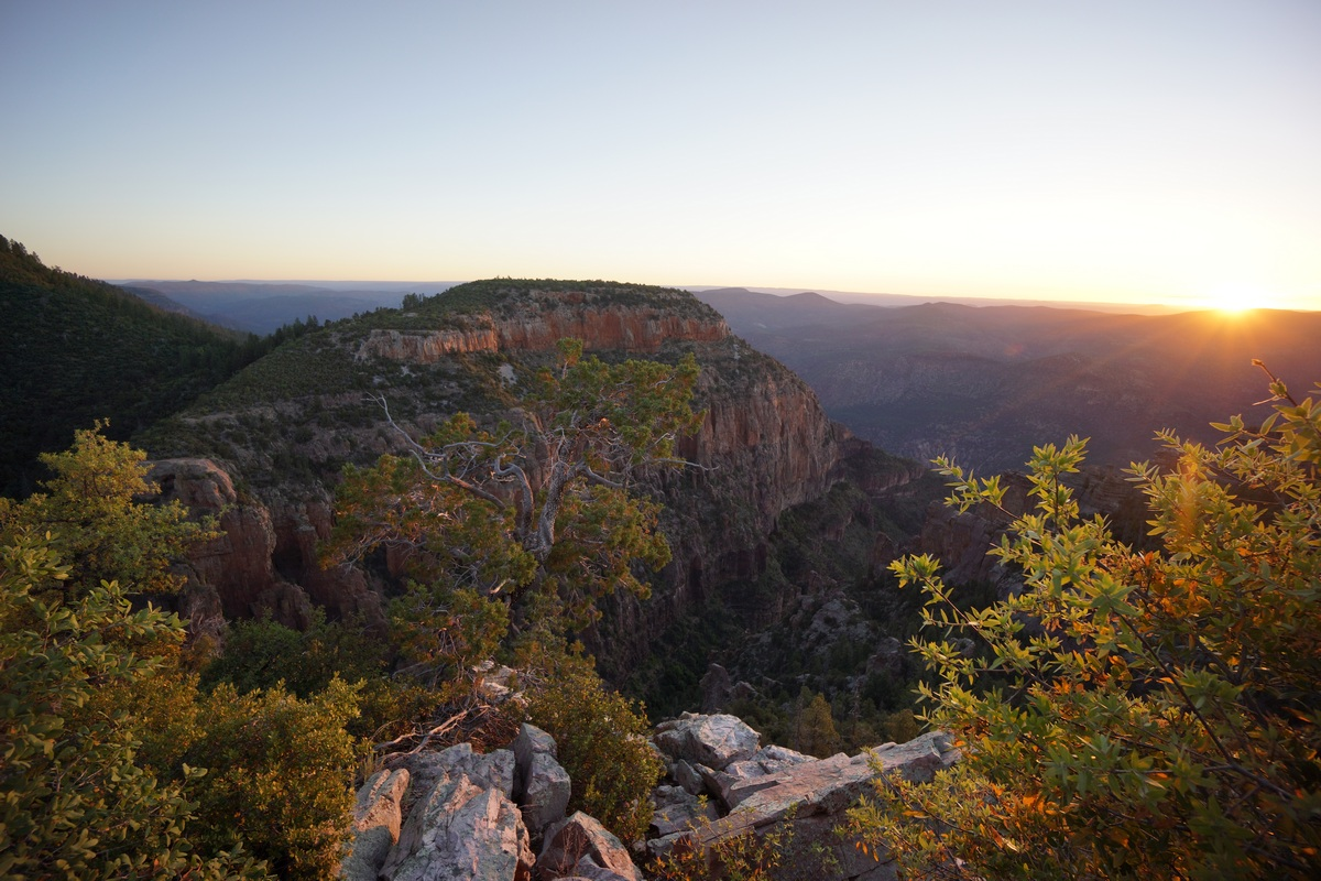 a view of the sunrise over pueblo canyon