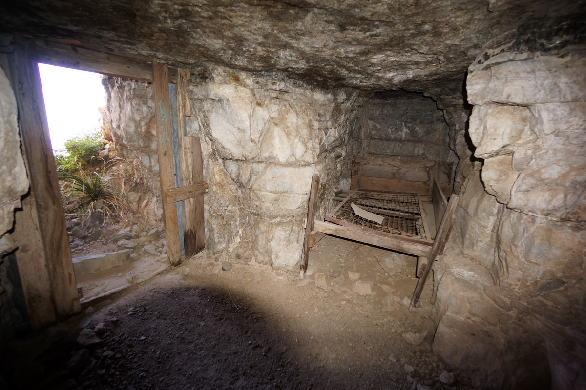 an old bed inside an asbestos mine