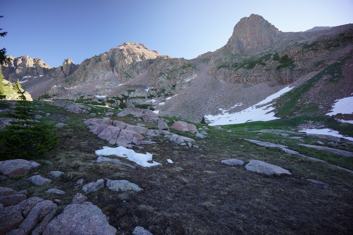 jagged peaks line the edges of a valley near snow lake in the eagles nest wilderness colorado