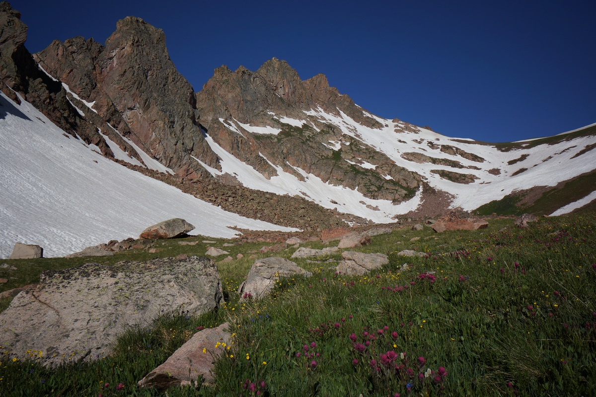 snow peak and jagged ridgeline above snow lake