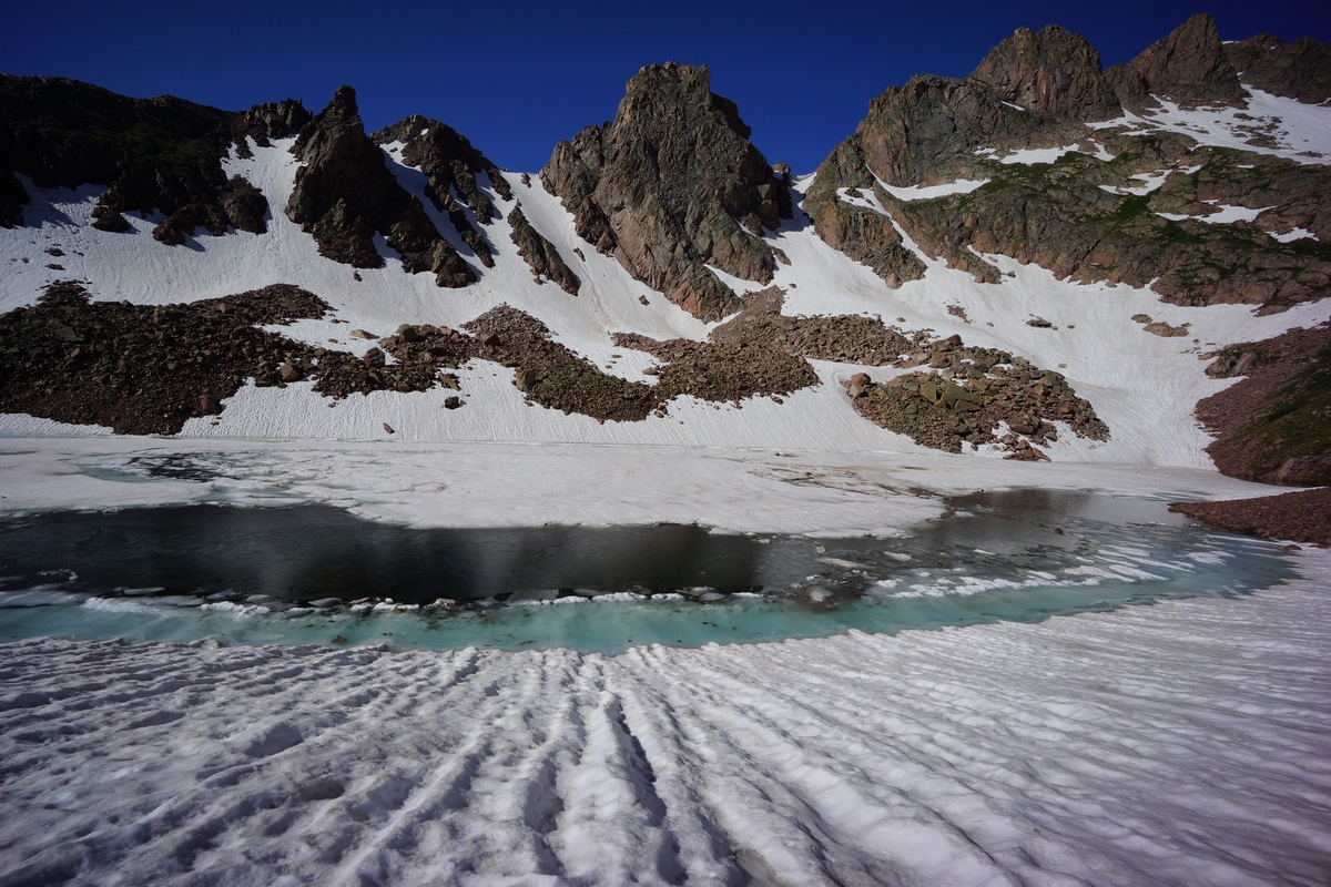 snow lake is partially (mostly) frozen in july - gore mountains colorado