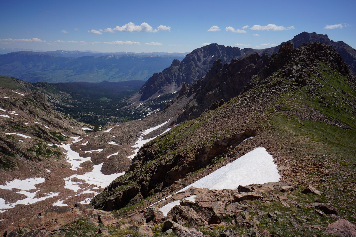overlooking south rock creek basin from hail peak ridgeline in the gore mountain range, colorado in july