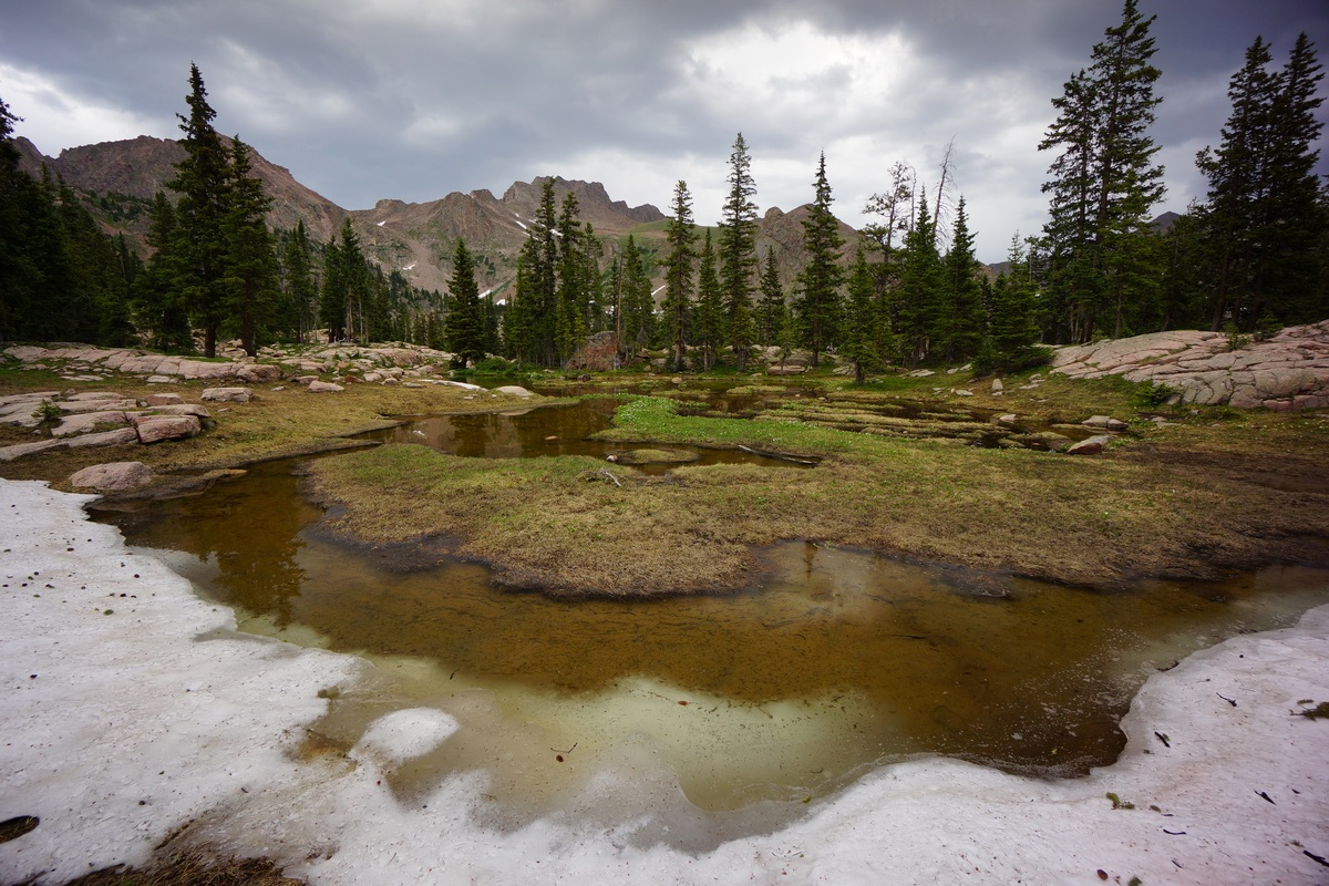 snow and melt water in the high country of eagles nest wilderness colorado in july
