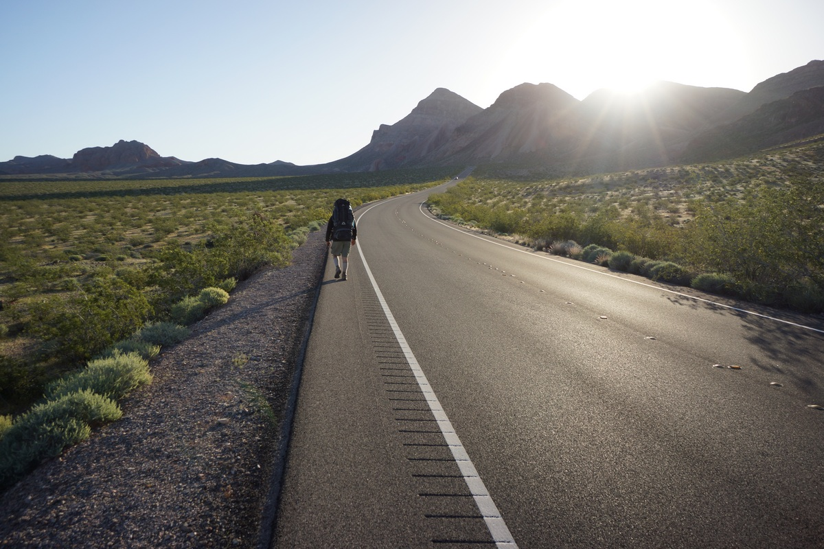 backpacker walking along northshore rd in the lake mead national recreation area