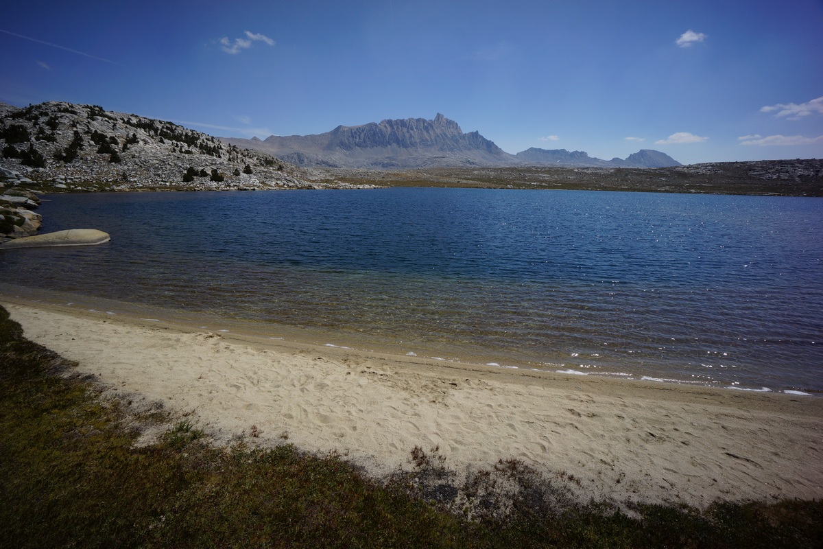 sandy beach on alpine lake in the sierras