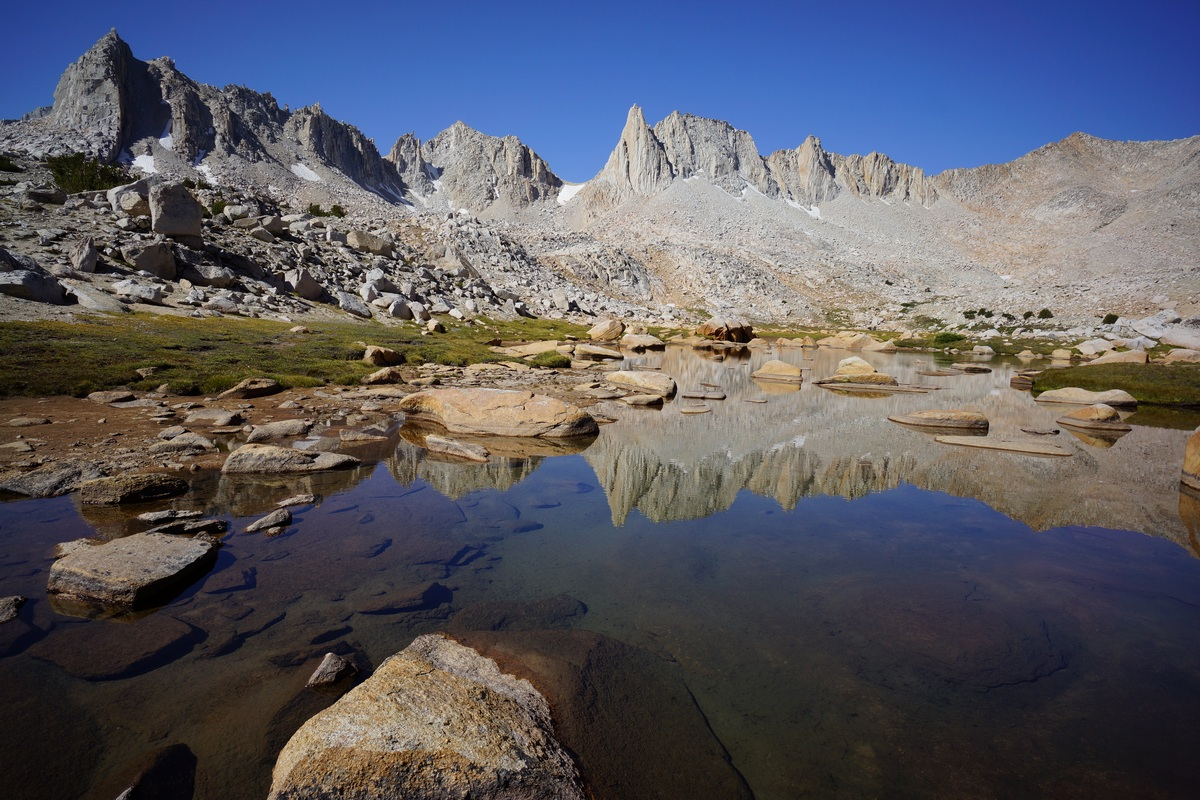 beautiful reflection of jagged peaks on a lake in granite park