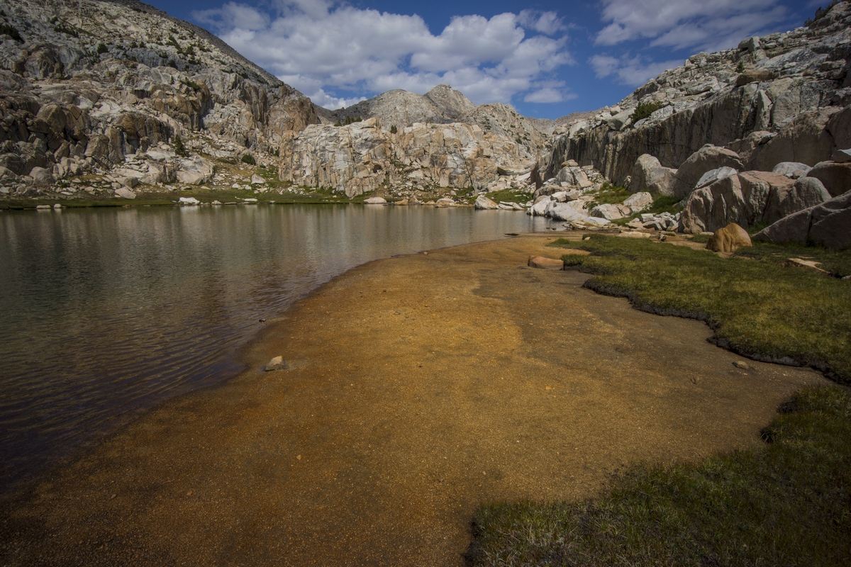 sandy beach on little bear lake in the john muir wilderness