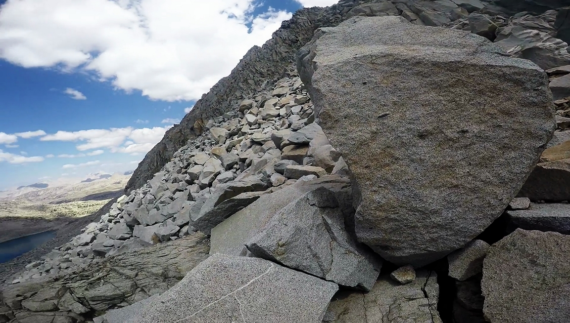 huge boulders on goethe lakes side of alpine col