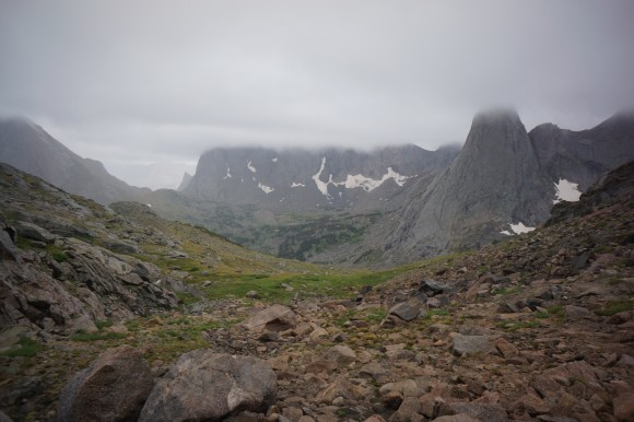 view of cirque of the towers and pingora peak obscured by clouds