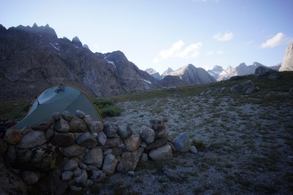 campsite titcomb basin with rock wall