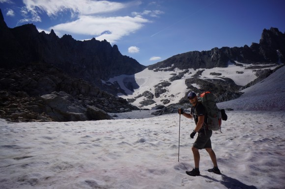 wind river range hiker in snow with shorts