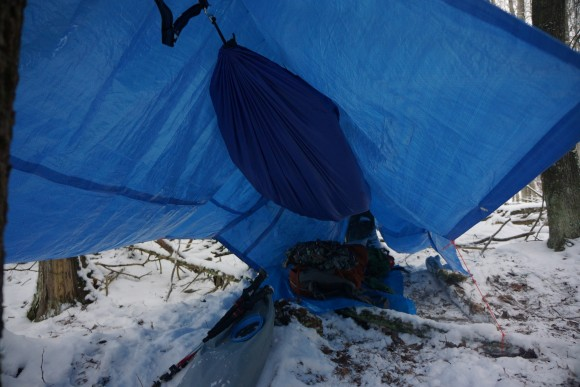 hammock with blue tarps overhead for rainfly