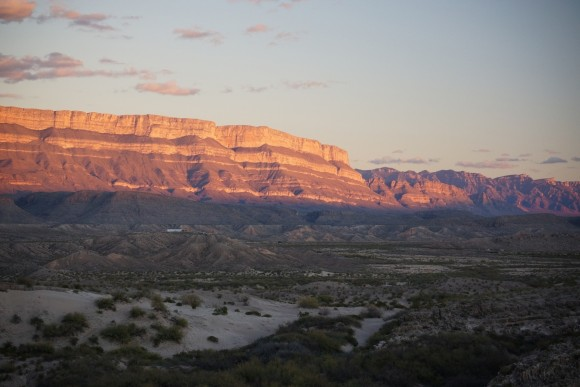 Sunset illuminating the Sierra Del Carmen mountains just behind the village of Boquillas, Mexico as seen from an overlook in Rio Grande Village, Big Bend National Park, Texas.