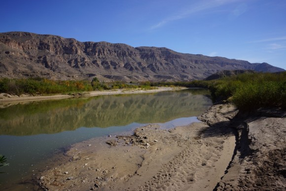 walking along the rio grande river in mexico towards boquillas canyon