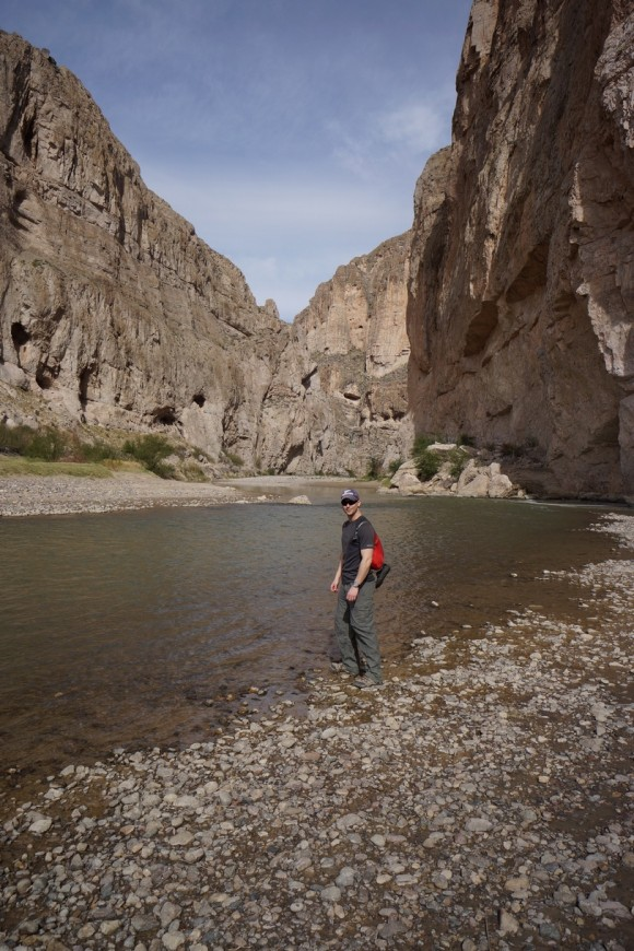 standing along the rio grande river in boquillas canyon, mexico