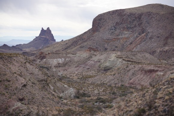 view of mule ears with soem badlands in the foreground