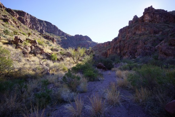 sun illuminating one side of a canyon in big bend hiking up to jacks pass