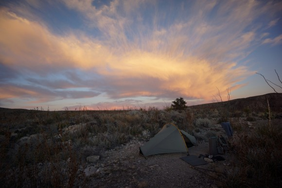 orange sky behind tent mariscal canyon overlook big bend