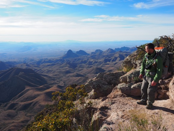 hikier standing on the edge of the south rim in big bend national park chisos mountains