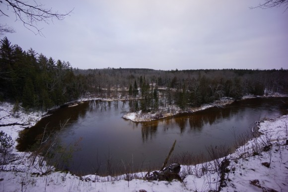 river bends of mansitee river in michigan during winter