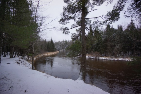 at the banks of the manistee river in winter