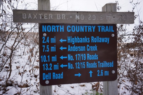 a sign along the north country trail near baxter, mi