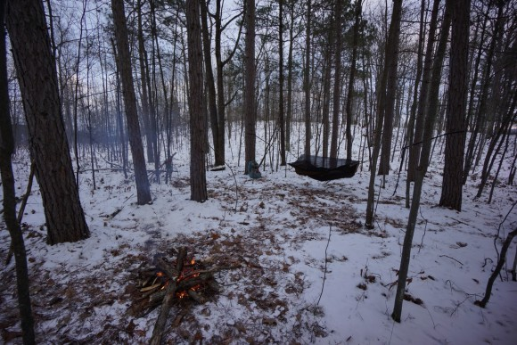 winter camping in michigan hammock hanging with campfire burning